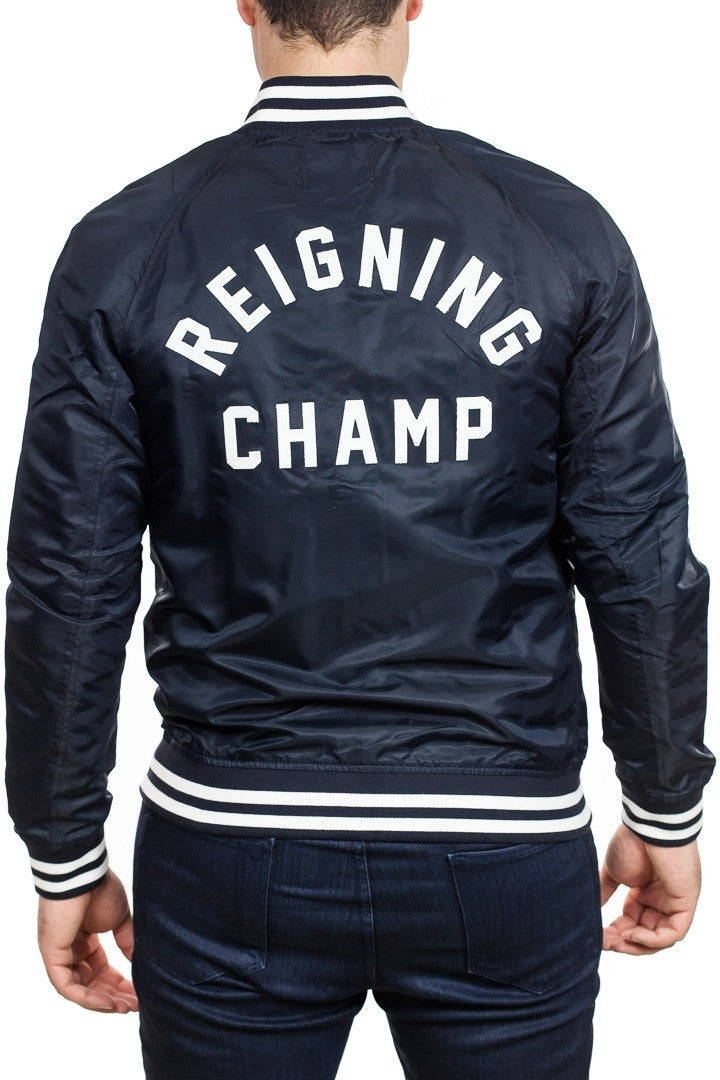 Reigning Champ Logo Stadium Jacket in Navy