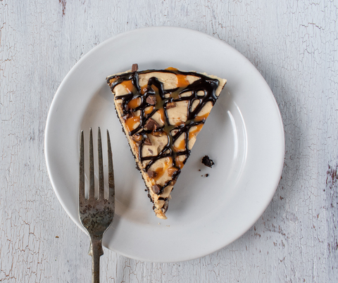 cbd peanut butter pie with chocolate and caramel drizzle slice
