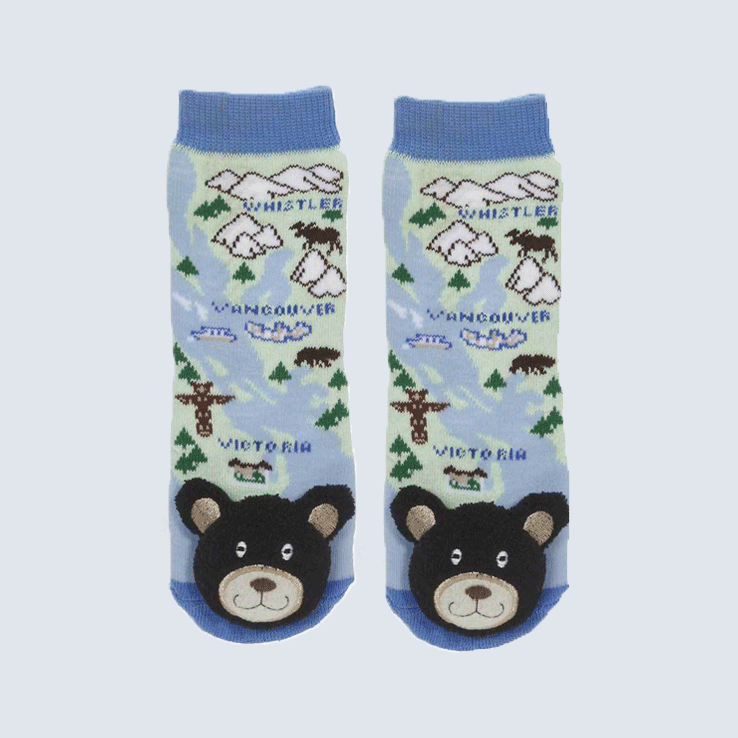 Two socks against a white background. Each sock features a map of British Columbia, and a black bear plush on the toe.