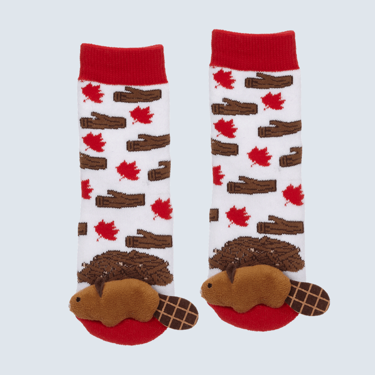 Two red and white socks against a white background. The socks feature a maple leaf and wood motifs. Each toe features a cute plush beaver.