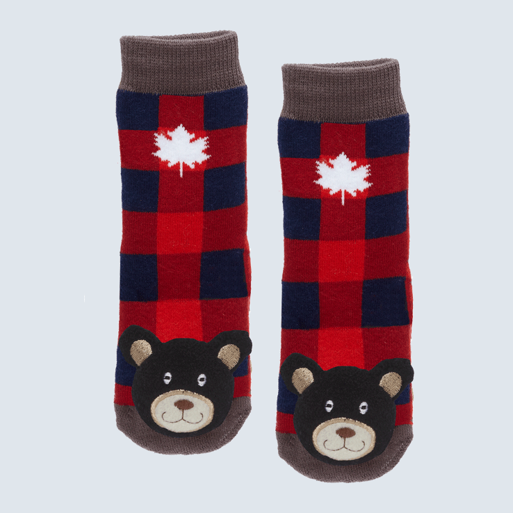 Two plaid socks against a white background. The socks feature a white maple leaf and a cute plush bear charm on the toe.