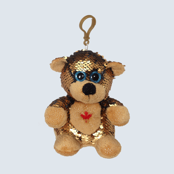 A sequin bear keychain against a white background.