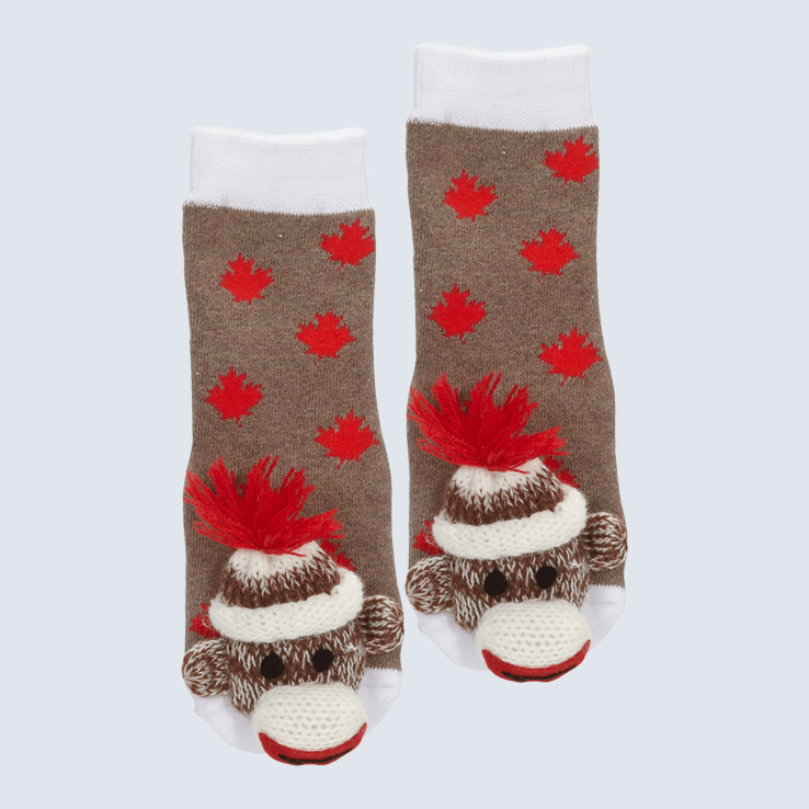 Two socks against a white background. The socks are made of a brown sock monkey fabric with red maple leaf motifs. Each socks has a monkey charm on the toe.