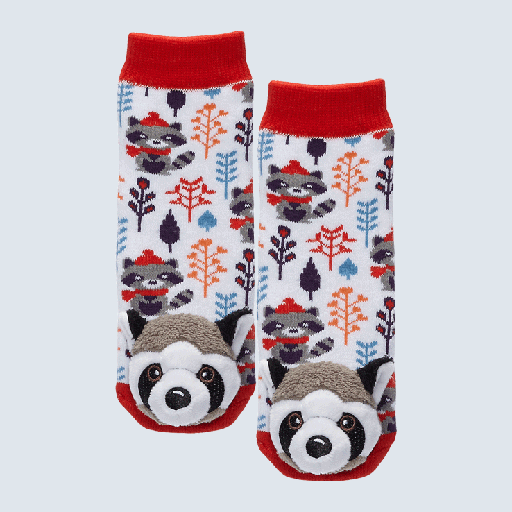 Two white, red, orange, and blue socks against a white background. The socks feature a Swedish style plant motif map and a raccoon plush charm on each toe.