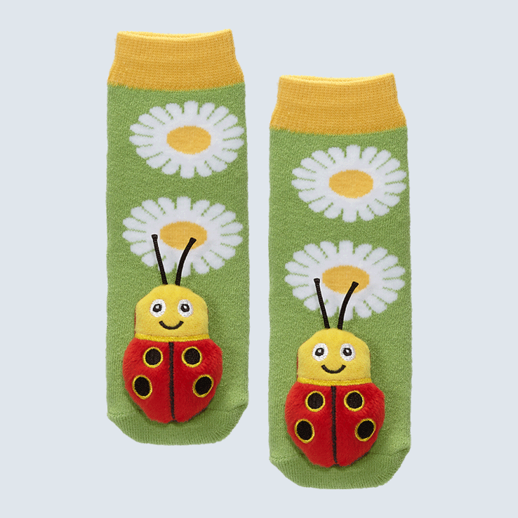 Two socks against a white background. The socks feature two daisies and a cute plush lady bug charm on each toe.
