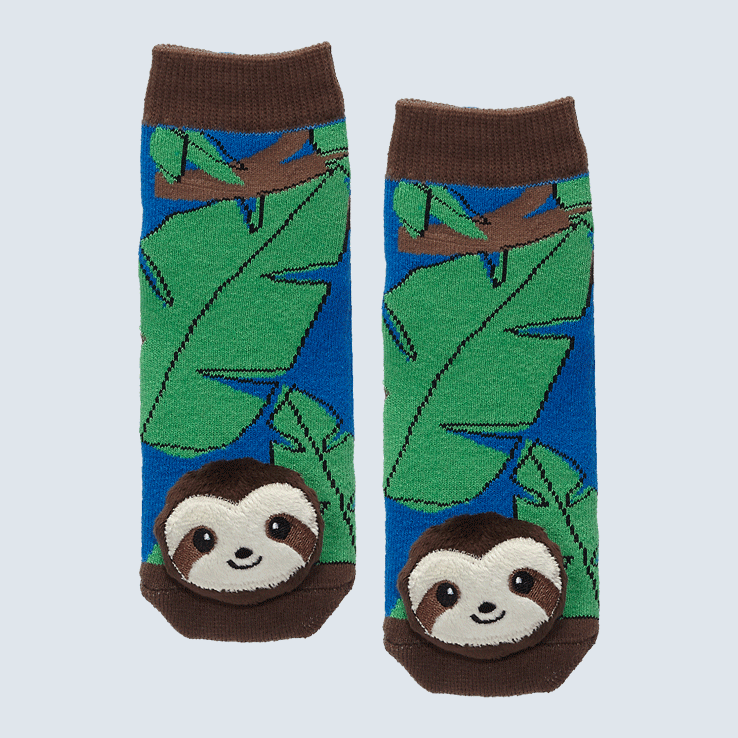 Two socks against a white background. The socks feature a leaf motif and a cute plush sloth charm on the toe.