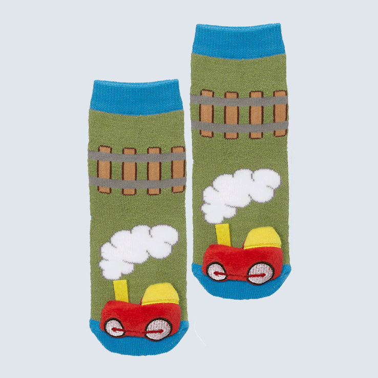 Two socks against a white background. The socks feature a train track pattern and a cute plush train charm on the toe.