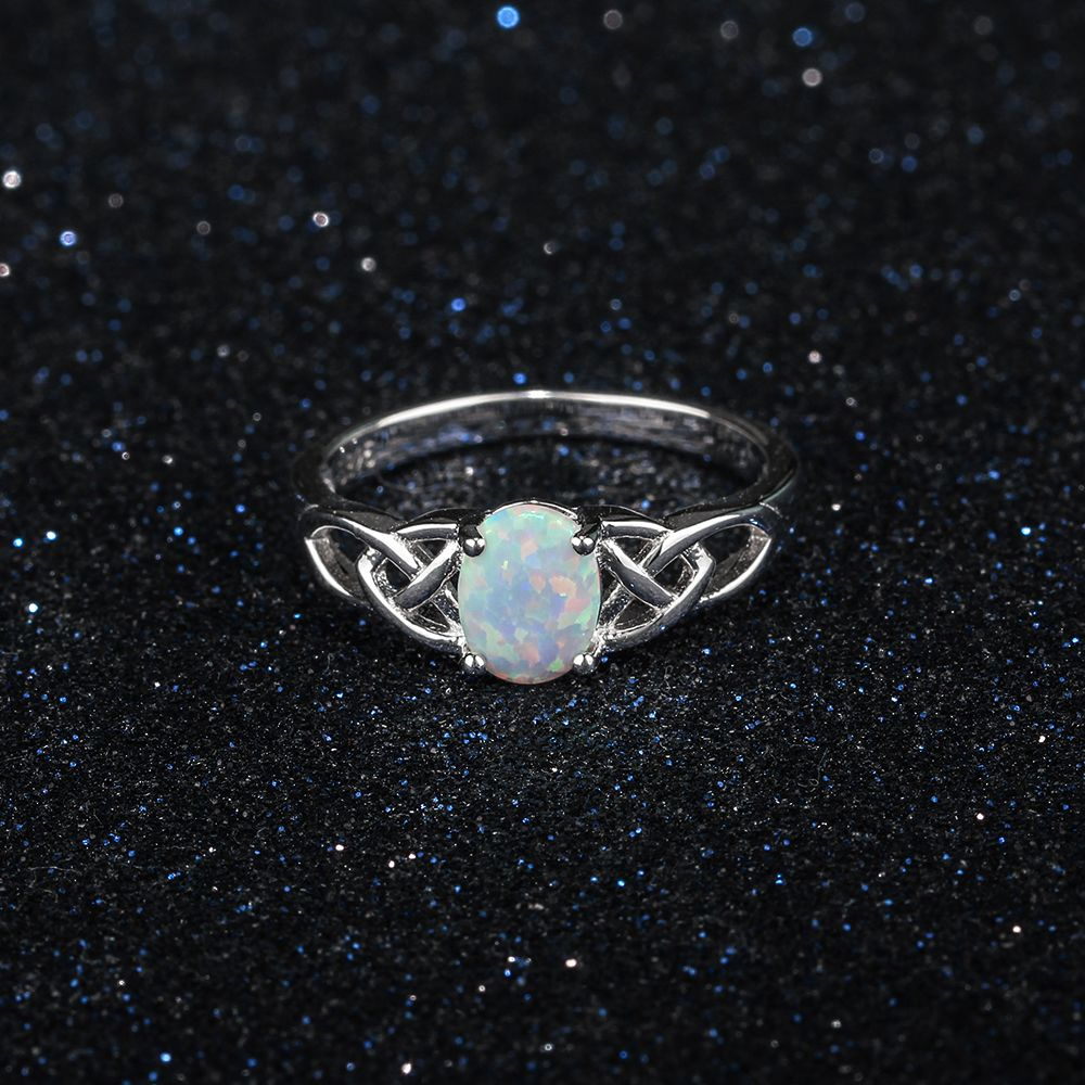 Elegant 925 Sterling Silver Braided Ring with Oval Opal Stone