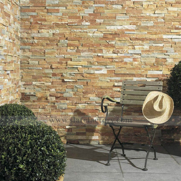 golden white stacked stone panels retaining wall