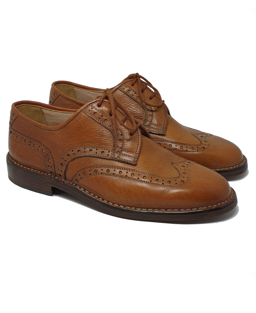 Calzatura derby brogue