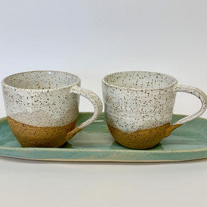 a. Pair of Oatmeal white cups
