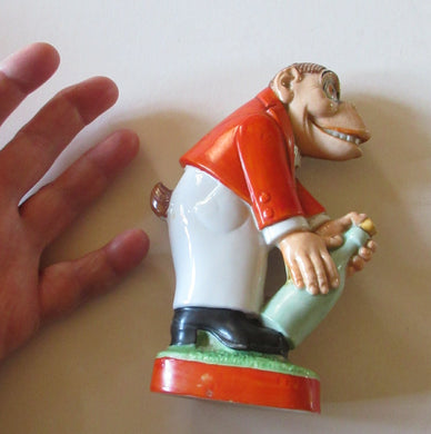 1920s SCHAFER & VATER Nipper Flask or Bottle in the Form of a Comical Monkey Opening a Bottle