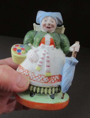 Bisque Porcelain Figure by Schafer & Vater. Match Holder in the Form of a Lady Carrying a Basket