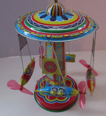 Products Vintage 2000 SCHYLLING Rocket Ride Carousel. Tin Plate Clockwork. Rotating Rockets. BOXED