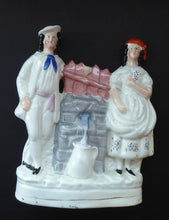 Load image into Gallery viewer, Antique STAFFORDSHIRE Flatback Figurine. Victorian Couple Standing Beside a Water Wall. Excellent Condition