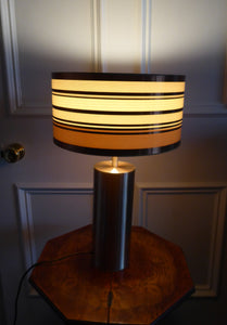 1960s Vintage Table Lamp with Tubular Gold Tone Metal Cylindrical Body and Original Metallic Stripes Drum Shade