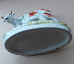 ANTIQUE STAFFORDSHIRE Figurine. Large Cow with her White Calf on Raised Oval Base; 1880s