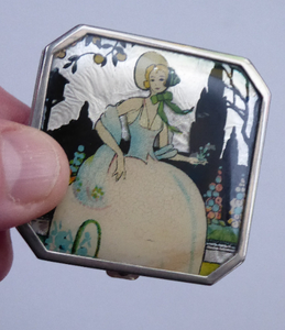 Vintage Art Deco Gwenda Celluloid Foil Miniature Powder Compact. Lid Decorated with an Image of a Pretty Lady in a Garden Setting