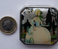 Load image into Gallery viewer, Vintage Art Deco Gwenda Celluloid Foil Miniature Powder Compact. Lid Decorated with an Image of a Pretty Lady in a Garden Setting