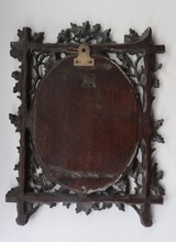 Load image into Gallery viewer, Antique 1880s BLACK FOREST MIRROR Frame in the form of an easel stand; decorated with intricate carvings of oak leaves & acorns