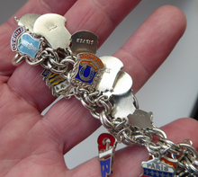 Load image into Gallery viewer, SILVER BRACELET with 36 Vintage SILVER and Enamel Towns Charms. Souvenirs of a Visit to the Town