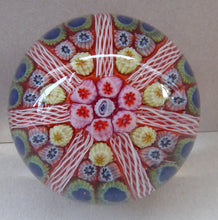 Load image into Gallery viewer, Collectable 1970s Scottish Glass Paperweight with 7 Spokes. Unusual Red Ground and Tutti Frutti Colours
