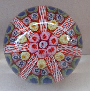 Collectable 1970s Scottish Glass Paperweight with 7 Spokes. Unusual Red Ground and Tutti Frutti Colours
