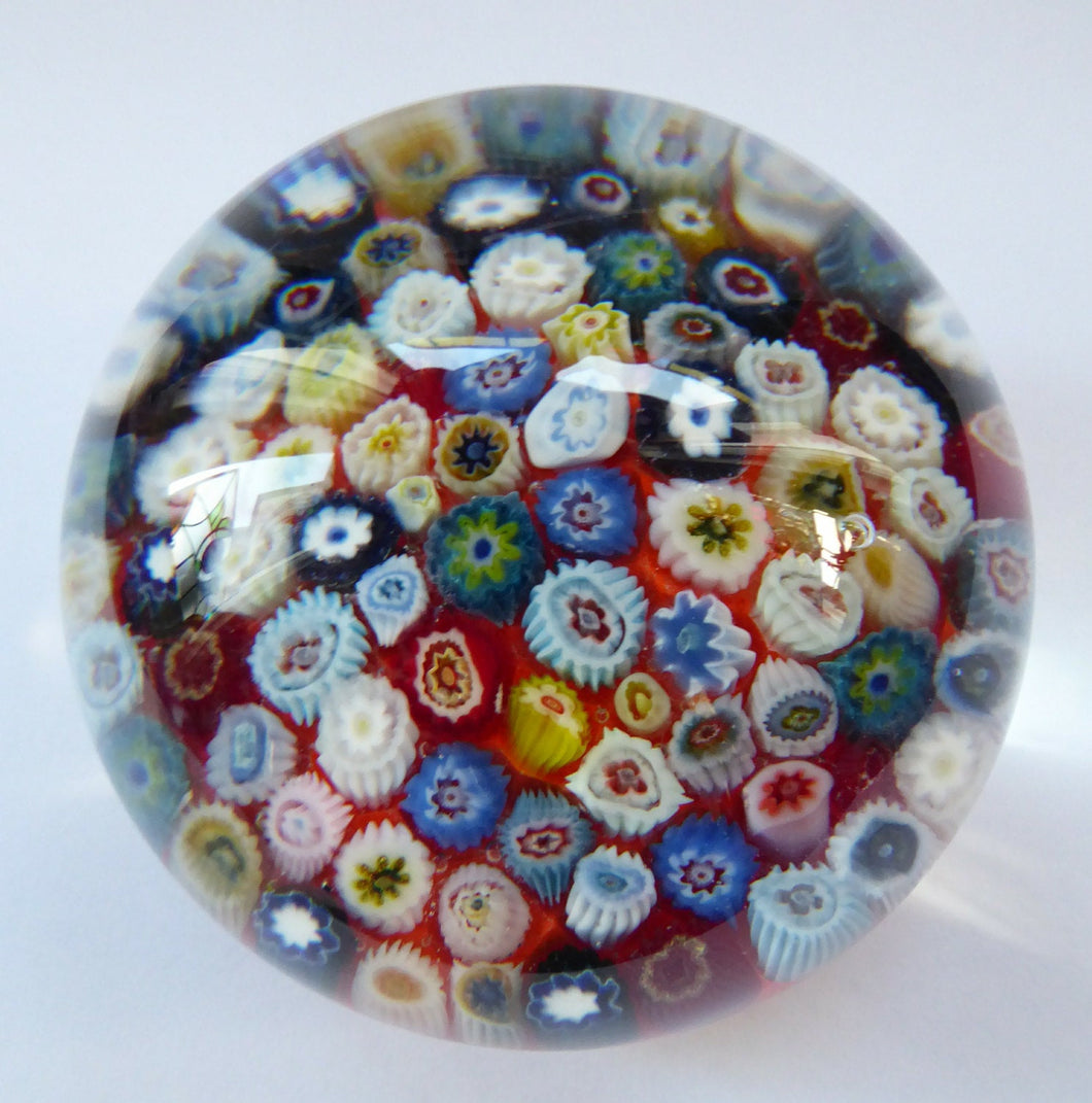 Vintage Scottish Paperweight, possibly by STRATHEARN GLASS. Scarlet Ground with a Carpet of Millefiori Canes