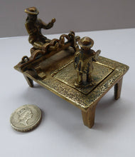 Load image into Gallery viewer, ANTIQUE INKWELL. An Extremely Rare Miniature Example Featuring a Little Man in Village Stocks Being Pelted with Fruit