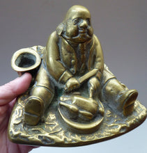 Load image into Gallery viewer, LARGE Antique Victorian Inkwell  Made of Cast Brass. Design features Daniel Lambert, Fattest Man Eating a Chicken, 1900s