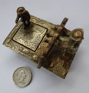 ANTIQUE INKWELL. An Extremely Rare Miniature Example Featuring a Little Man in Village Stocks Being Pelted with Fruit