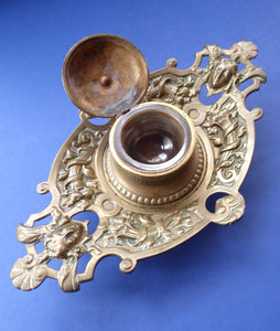 BRASS INKWELL. Finely Made High Victorian Antique Desktop Example with Mask Details & Cornucopia; Glass Liner