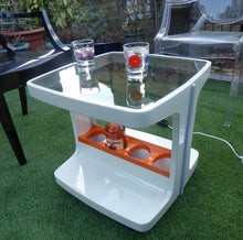 Load image into Gallery viewer, Original SPACE AGE 1970s Marc Held Drinks Trolley with Smoked Glass Top. White Plastic with Orange Bottle Holders