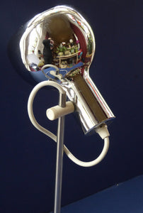 1960s CHROME DESK LAMP with movable shiny chrome shade, and on / off switch on the base. Good Condition