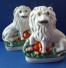 Load image into Gallery viewer, ANTIQIUE Pair of Staffordshire Lions Showing the British Lion Trampling on a Recumbent Figure of the French Emperor, Napoleon III