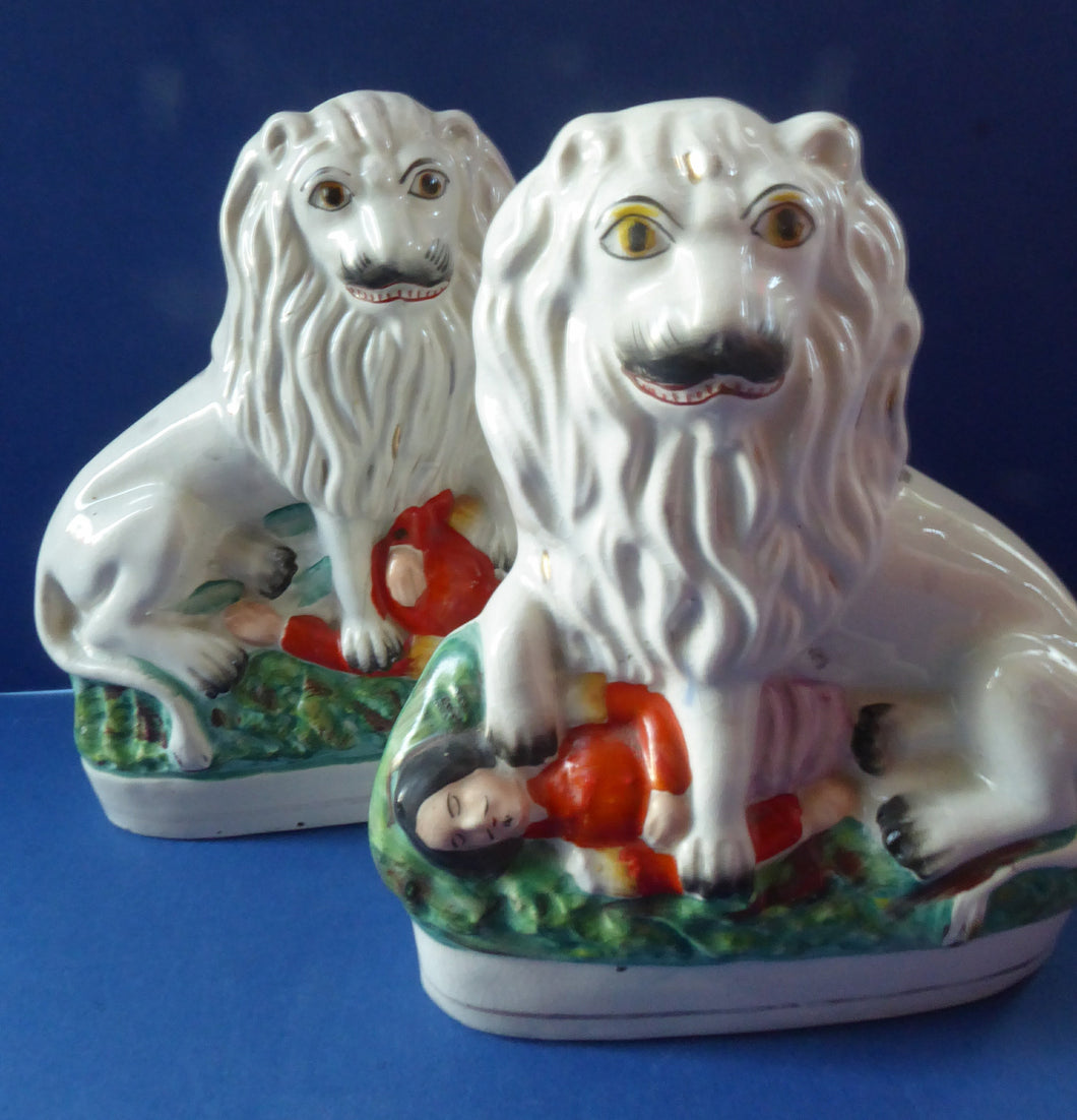 ANTIQIUE Pair of Staffordshire Lions Showing the British Lion Trampling on a Recumbent Figure of the French Emperor, Napoleon III