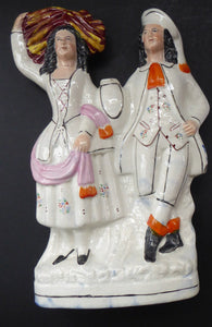 LARGE Antique STAFFORDSHIRE Figurine of a Country Couple who have been harvesting; Height 12 1/2 inches