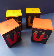 Load image into Gallery viewer, FOUR Vintage Pyrex Tumbler Set. Original Card Boxes - Space Age Yellow and Red 1/2 pint Tumblers with plastic holders