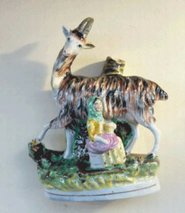 STAFFORDSHIRE POTTERY. Strange Victorian Spill Holder featuring a milkmaid and a massive goat