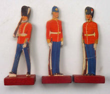 Load image into Gallery viewer, 1950s Tin Containing a Selection of Ten Printed and Mounted on Card Soldiers - with Wooden Stands. Rare and Unusual Item
