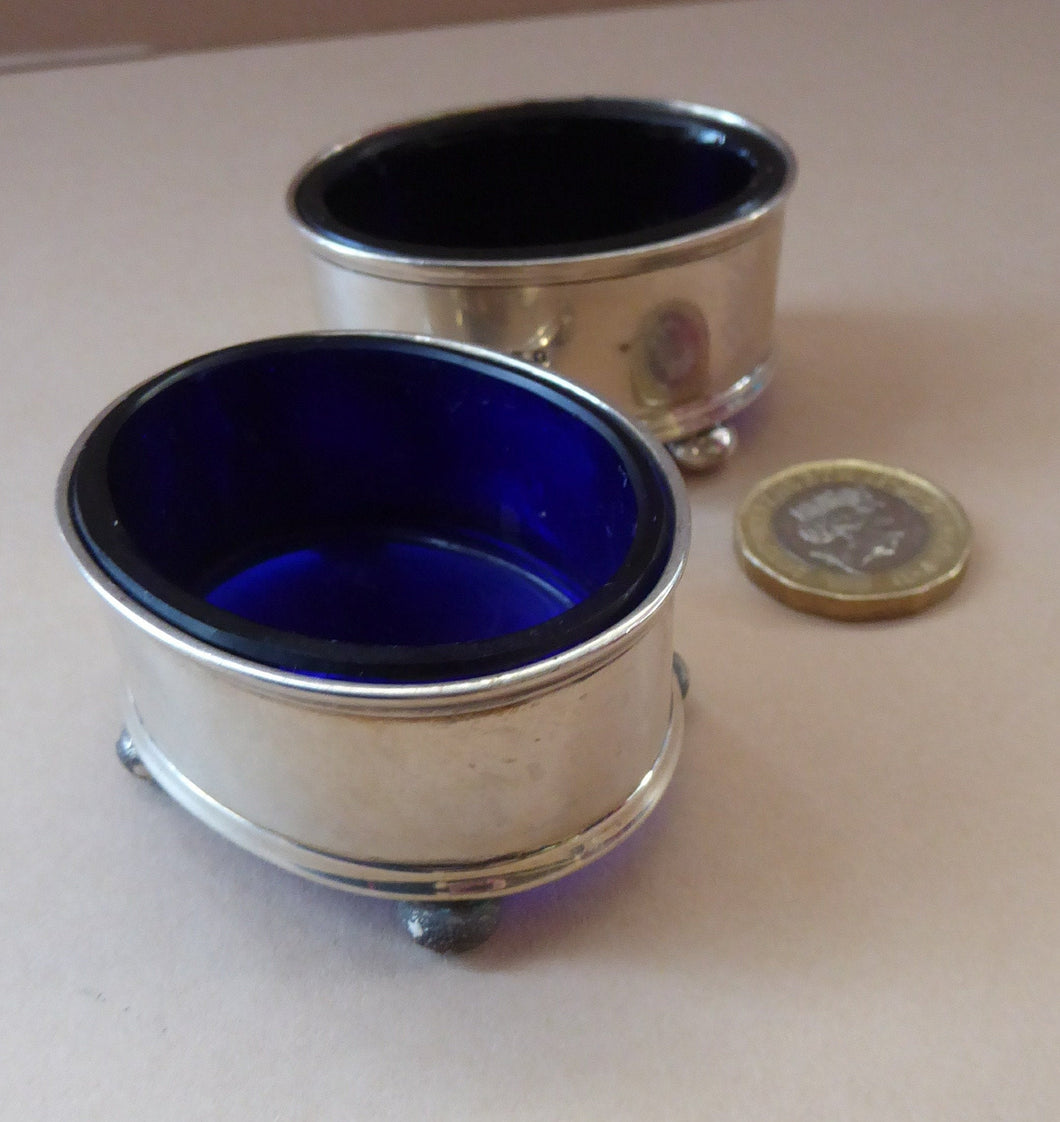 1921 SOLID SILVER Pair of Table Salts with Simple Design. Original Fitted Bristol Blue Glass Liners. Excellent Condition.