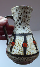 Load image into Gallery viewer, Vintage 1970s West German Pottery Handled Vase or Pitcher. JASBA WARE with Orange Polka Dot Pattern. 6 3/4 inches high