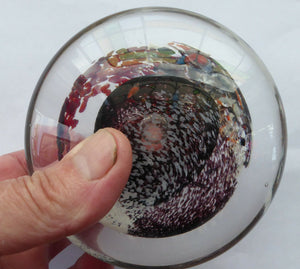 SCOTTISH STUDIO GLASS. Discus Shaped Paperweight with Abstract Swirls. Designed by Jane Charles