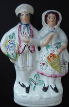 Load image into Gallery viewer, ANTIQUE Victorian Staffordshire Figurine. Lovely Wee Man and Woman with Baskets Full of Flowers