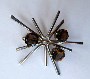 SCOTTISH SILVER 1970s ORTAK Starburst Brooch. Designed by Malcolm Grey.  Set with Three Smoky Quartz Stones. Hallmarked