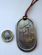 Load image into Gallery viewer, Vintage NORWEGIAN Pewter Pendant with Ancient Cave Carving Images. Original Leather Hanging Thong