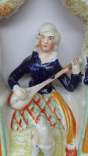 Load image into Gallery viewer, ANTIQUE Victorian Staffordshire Figurine. Lady Dressed in a Short Plaid Skirt Seated Under a Bough Playing a Lute