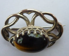 Load image into Gallery viewer, Stylish Vintage Scottish Silver Brooch. Made in Edinburgh and Hallmarked for 1978. Tiger's Eye Stone