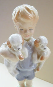 Royal Worcester Figurine MONDAY'S CHILD.  Modelled by Freda Doughty. No 3519. Boy Holding Puppies. PRISTINE