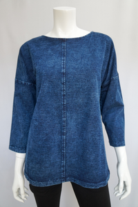 The Your Song collection is exclusive to Rhumba. An updated line of soft stretch denim jackets, dresses and tops in stylish designs with flattering silhouettes, textured accents and decorative details; designed for everyday wear by fashionable women with a comfy relaxed fit in solid denim blue or fun painted denim.